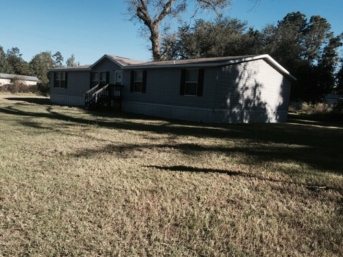 5/3 Vision Doublewide Mobile Home On 3.39 Acres In Warren, Texas – $59,000